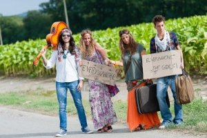 15121330-hippie-group-hitchhiking-on-a-countryside-road-italy